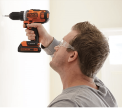 male using a black & decker drill
