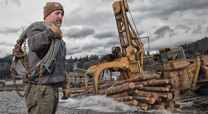 Logger in carhartt apparel at a loggin site