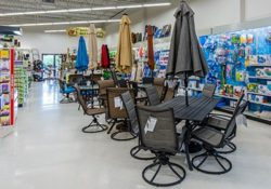 patio sets and pool supplies in the outdoor living section of Bibens Ace Essex