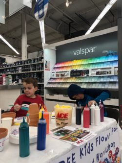 kids painting flower pots at bibens ace south burlington with valspar in background