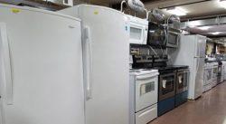 A row of large appliances including refridgerators, stoves, etc.