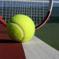 Tennis ball, tennis racket head on court