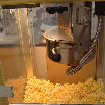 Yes, we offer hot popcorn! Come in and get some.