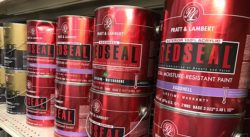 Pratt & Lambert paint cans lined up on a shelf.