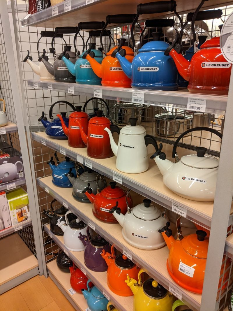 full shelf of le creuset teapots in different colors at ace hardware in montana