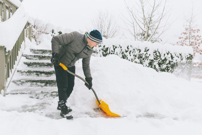 History of Snow Blowers, Man shoveling snow