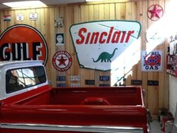 Yesterday's Ride Sinclair Sign on Wall over truck bed