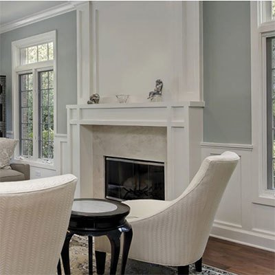 Moulding millwork image of fireplace and window moulding.