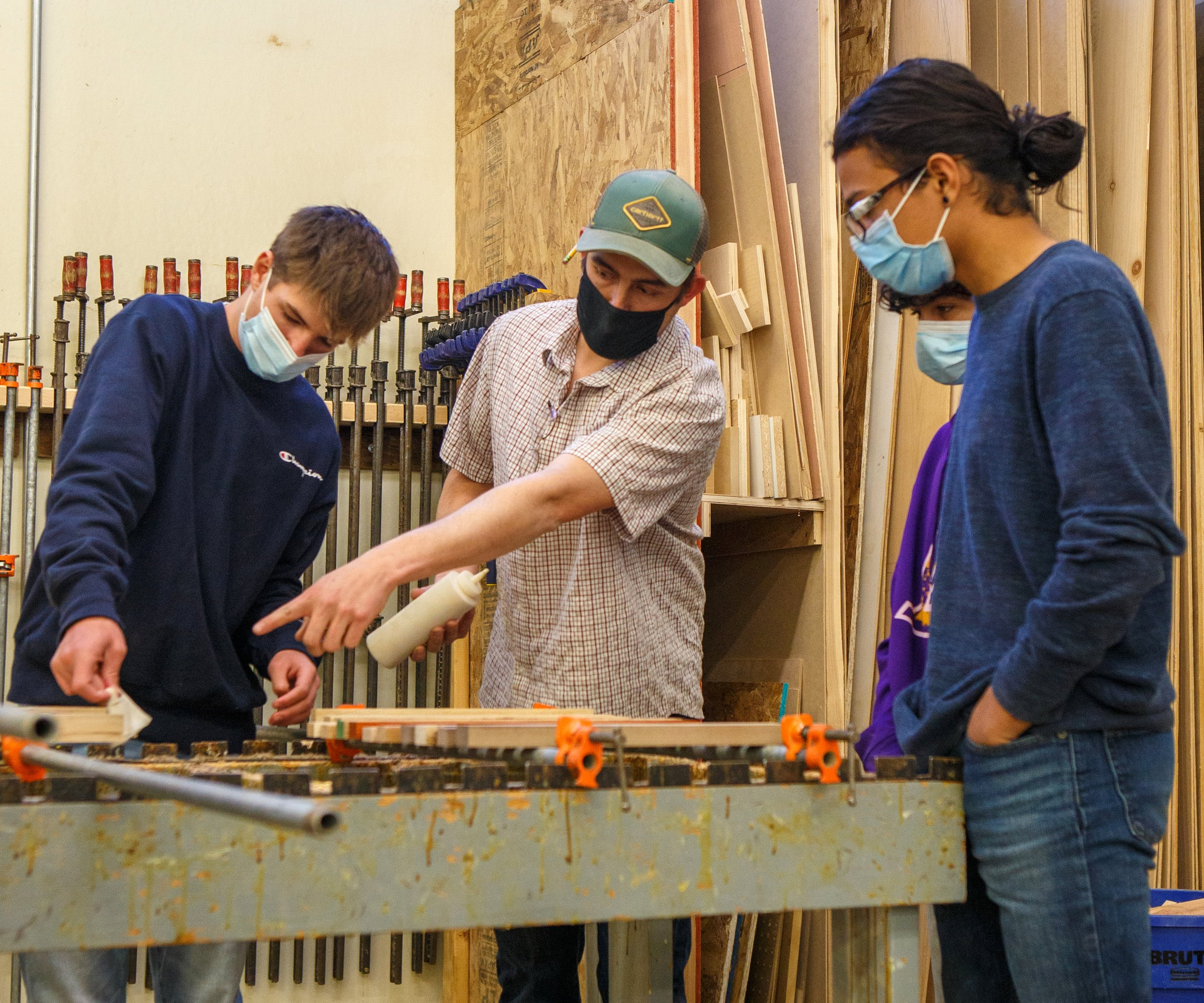 Michael Black (center) is finally getting to teach shop in person after months online. Photo by Sue Rollyson
