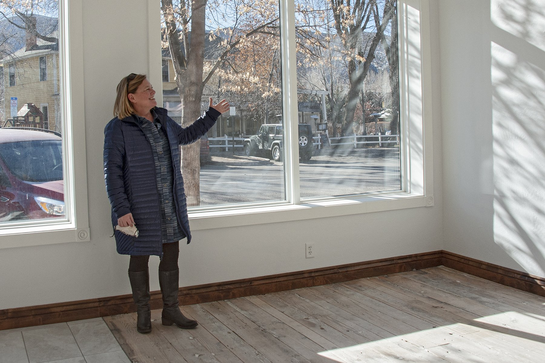 Art Base Executive Director Skye Skinner shows how the large first floor gallery space will be located to attract the interest of people strolling by on Midland Avenue. Photo by Roberta McGowan