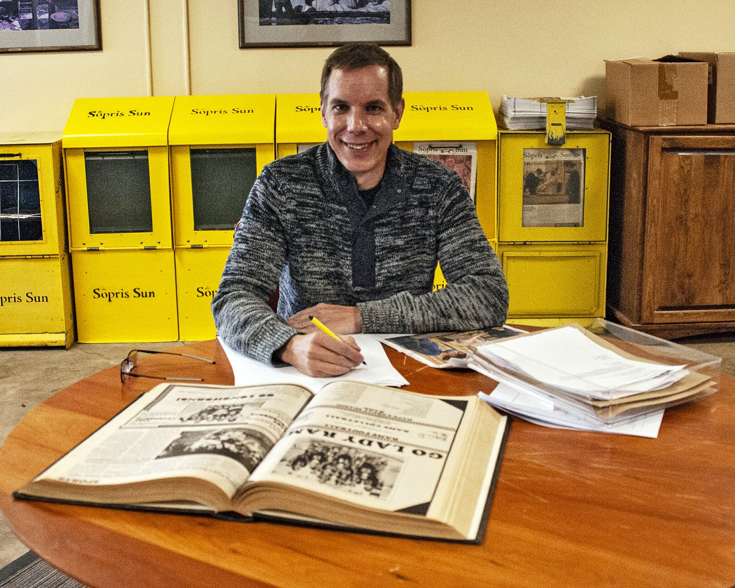 Newly-named Executive Director Todd Chamberlin works on new projects to expand the advertising and reach throughout the valley. Photo by Roberta McGowan