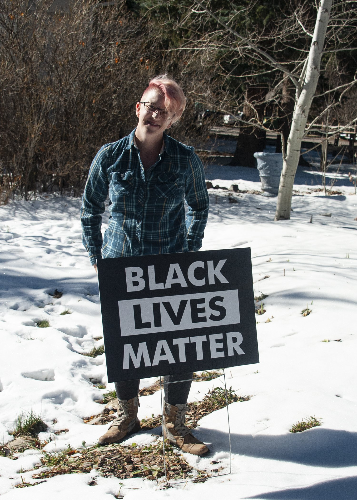 Redstone's Gentry Houghton places a Black Lives Matter in her front yard. Photo by Roberta McGowan.
