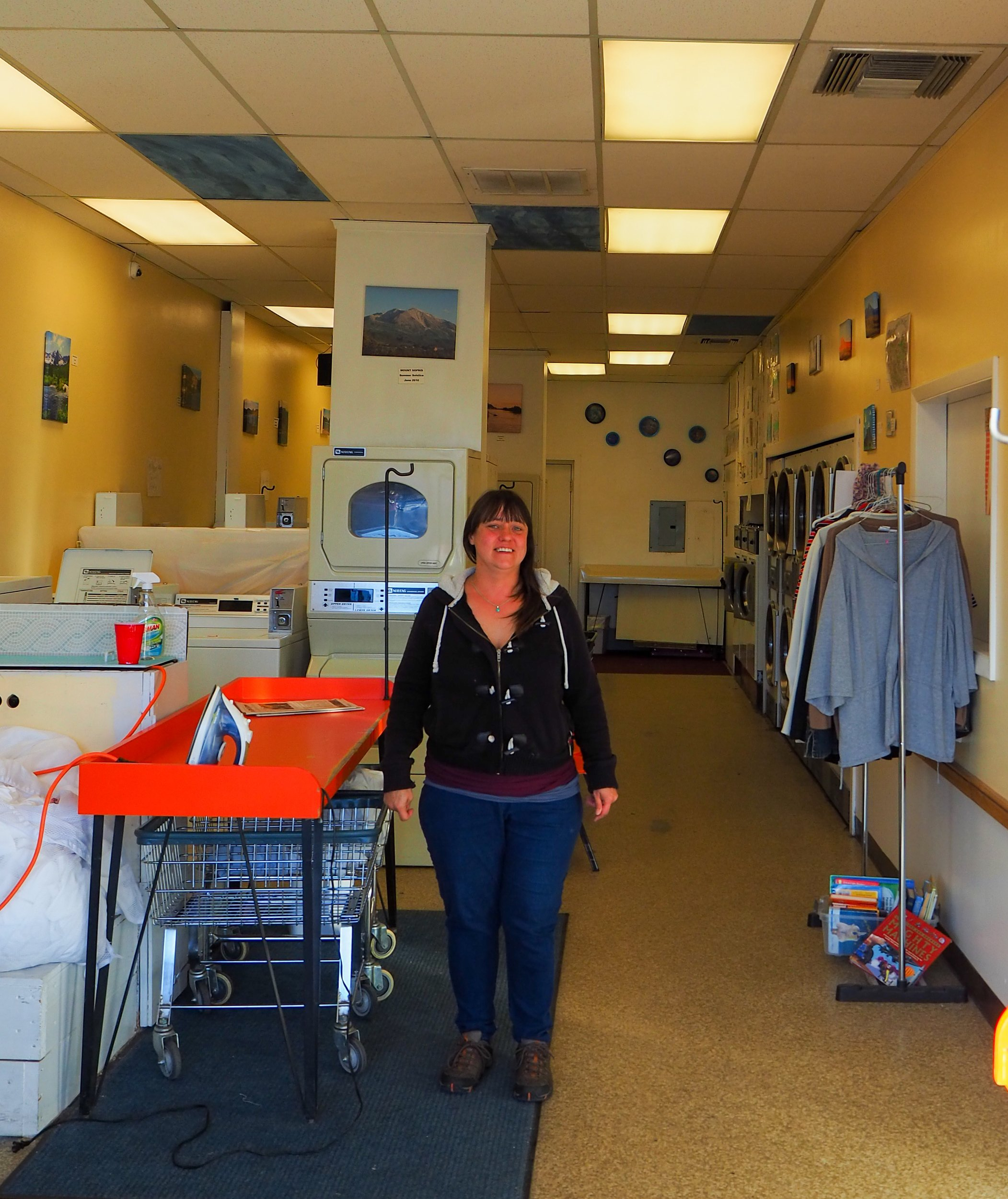 Heather Larson became a familiar face to Sopris Laundry customers after keeping the business running when Beatriz Lowick passed away. Bea's photographs continued to adorn the walls until the business closed. Photo by Raleigh Burleigh.