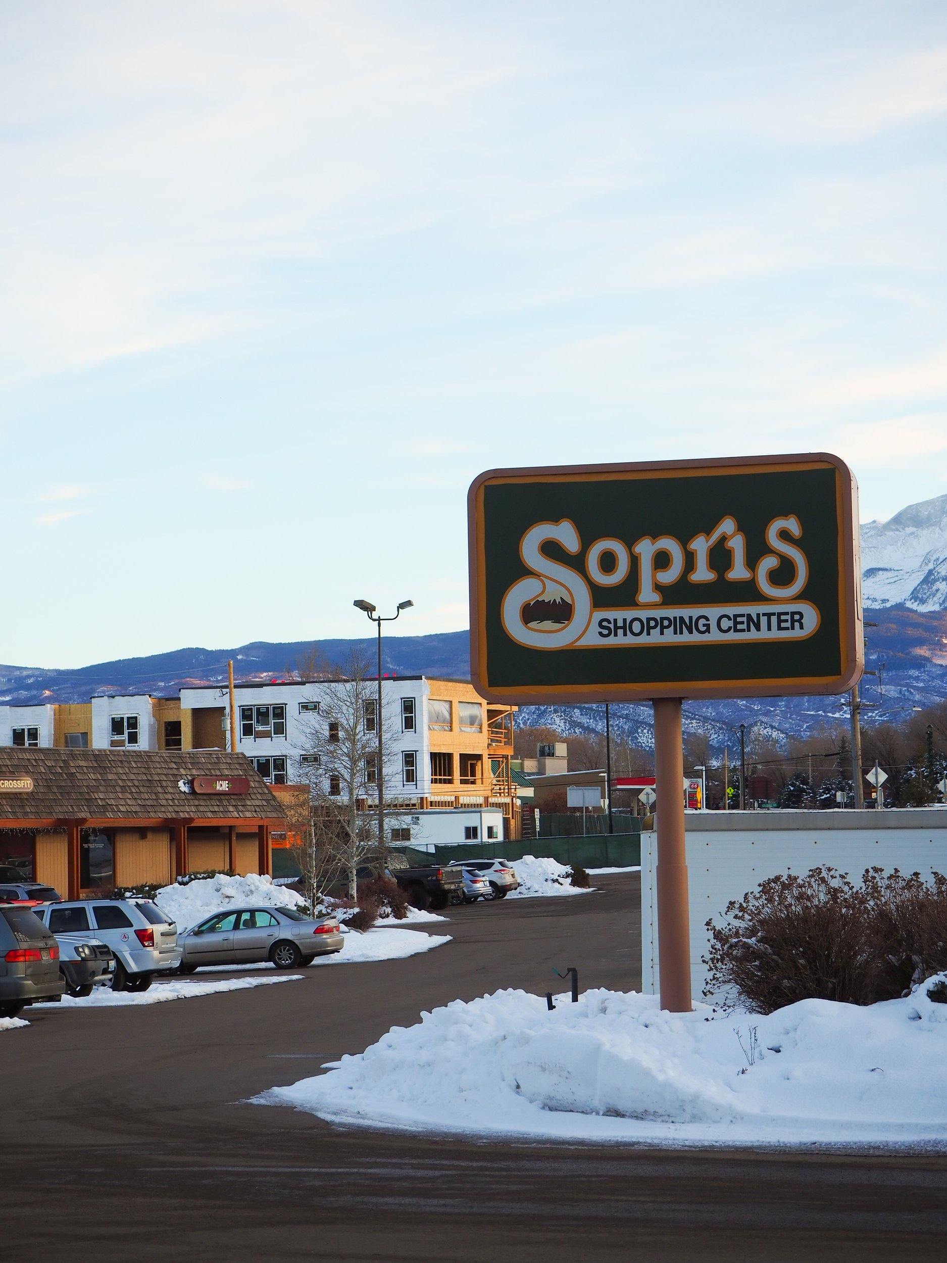 "BUSINESS COSTS Proposed redevelopment of the Sopris Shopping Center would add 76 new rental units to Carbondale's housing inventory – 15 being deed-restricted and 64 ""efficiency"" apartments, measuring 415 to 725 square feet. Meanwhile, nine locally-owned businesses see themselves displaced, mid-pandemic. More on page 8. Photo by Raleigh Burleigh."
