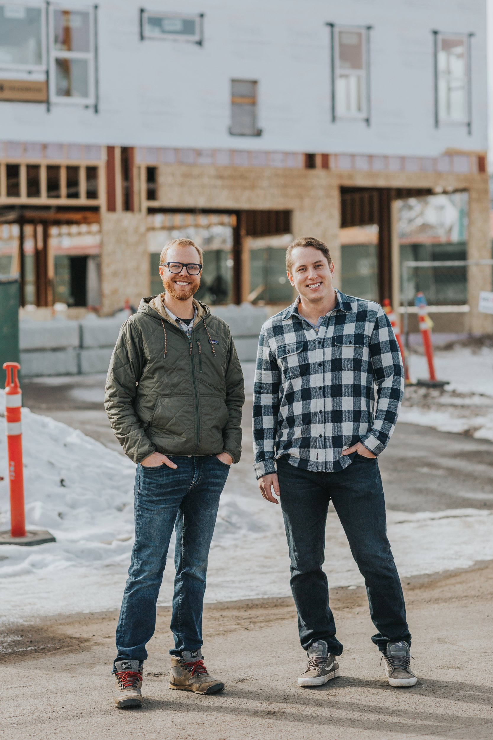 Mark Hardin (left) and David Eisenson (right) stand on Colorado Avenue in front of the partially-constructed building that will house their deli, Plosky's, which will feature bagels and lox, reubens, pastrami on rye and other classic New York sandwich fare. Photo by Olivia Emmer.