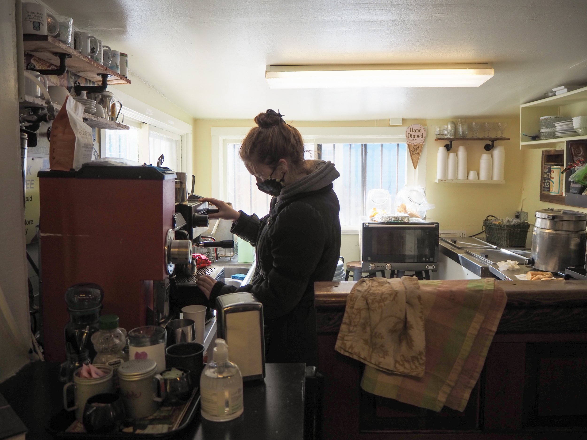 The Redstone General Store is now open and offering 10 flavors of Colorado ice cream. Annalise Basso prepares espresso to accompany a brisk afternoon. Photo by Raleigh Burleigh.