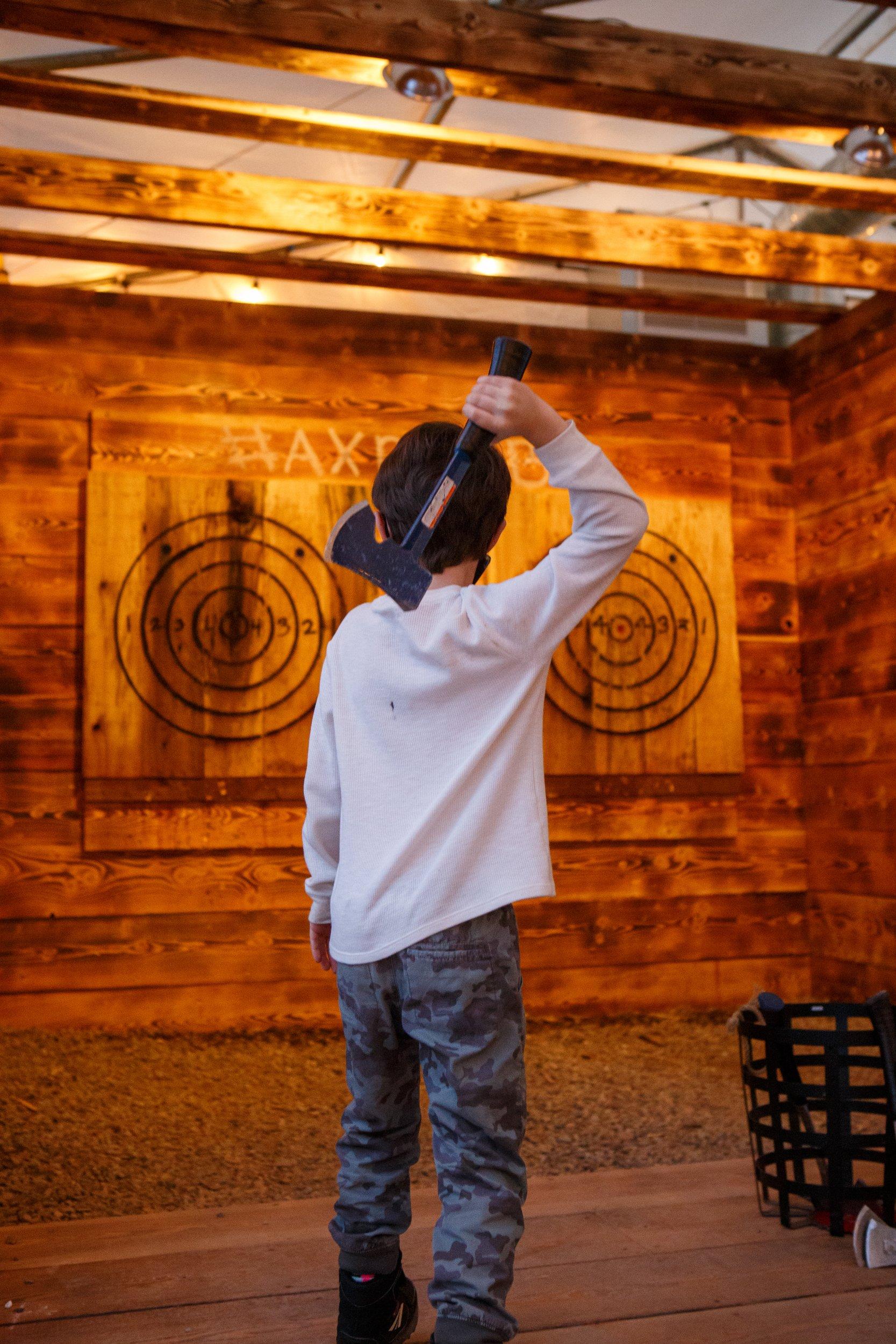 A young participant practices his axe throwing. Photos by Sue Rollyson.