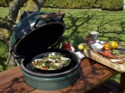 A Big Green Egg built into a picnic table