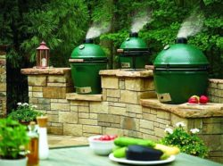 A beautiful deck with multiple Big Green Eggs