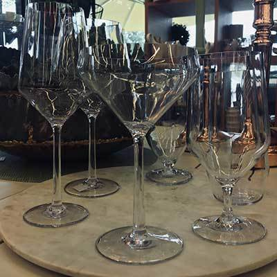 Display of 6 different stemware glasses for different beverages - Champagne, Red Wine, White Wine, etc.