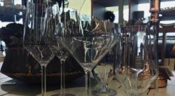 Display of 6 different pieces of stemware used for different beverages.