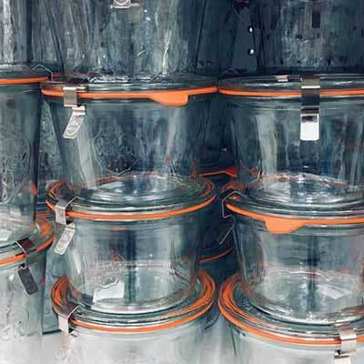 Image of stacks of clear glass canning jars