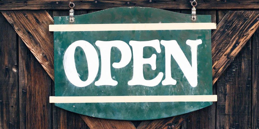 Open sign. Photo via Tim Mossholder, Unsplashed