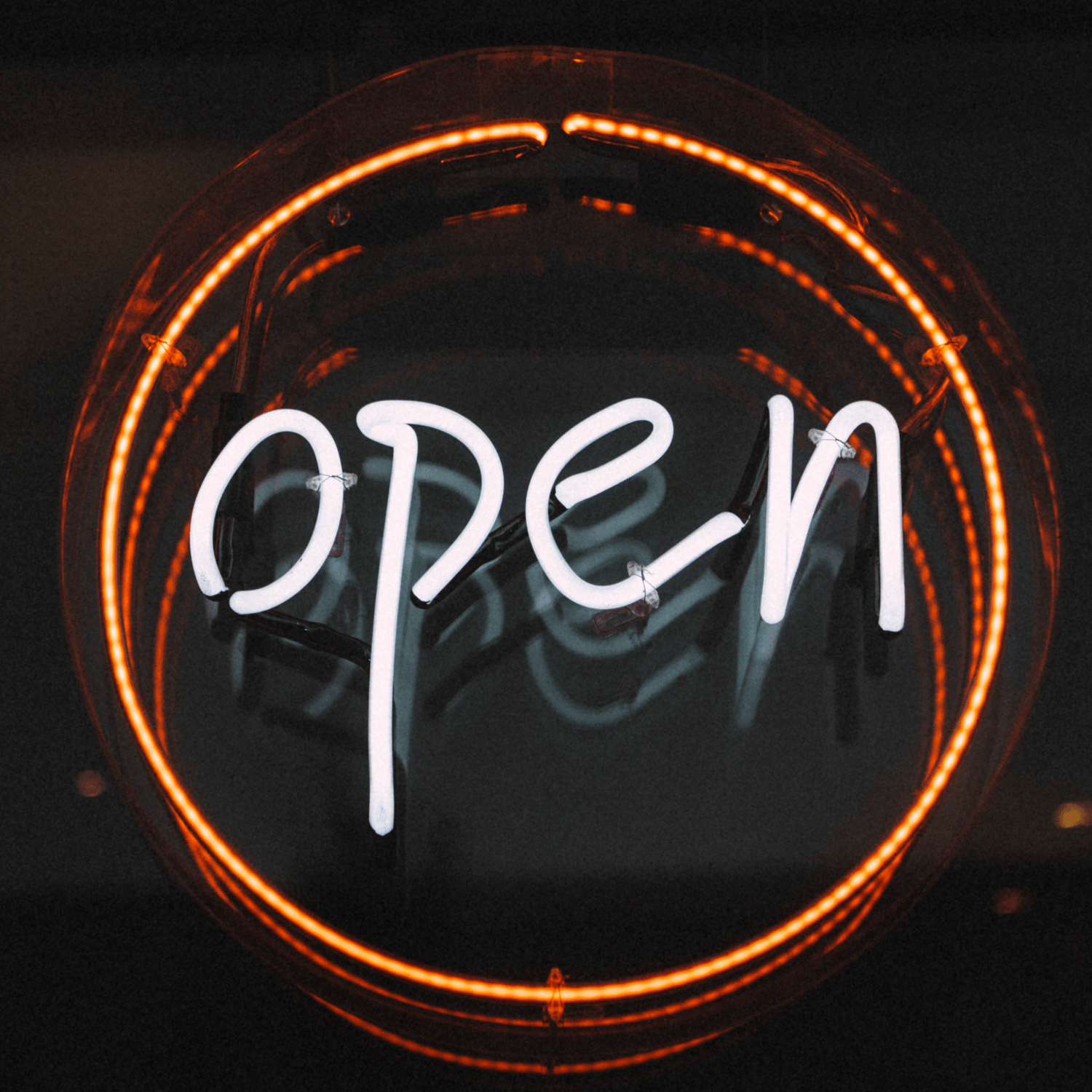 Orange Open sign, Photo by Finn Hackshaw on Unsplash