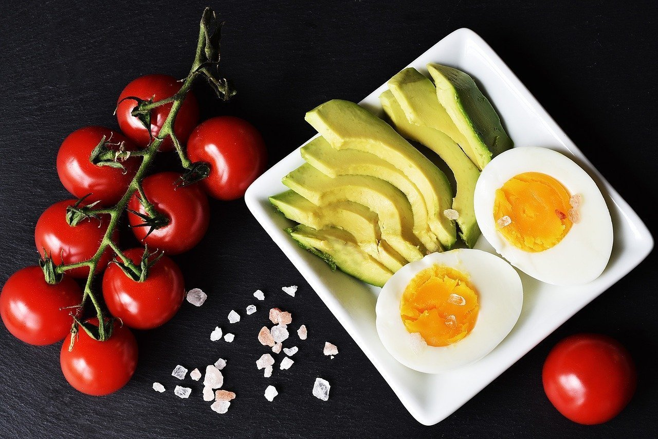 A healthy snack of tomatoes, avocado and boiled eggs