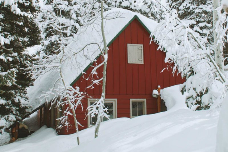 Red Cabin in the winter snow